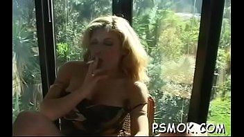 Ebon sucks a small cock while holding a lit cigarette