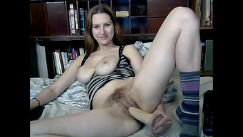 Busty cutie toys her hairy pussy on webcam preview image