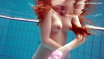 Naked pool stories - Redhead simonna showing her body underwater