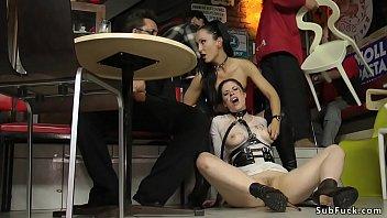 Brunette takes mouthful in public bar