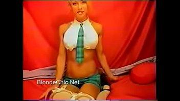 Blonde in stockings and high heels masturbating in green skirt