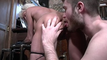 Granny Shanael enjoys strapon sex with a French guy and fucks him in his little tiny asshole!