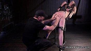 Busty slut anal fucked in metal device bondage