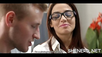 Nerdy playgirl impaled on strapon