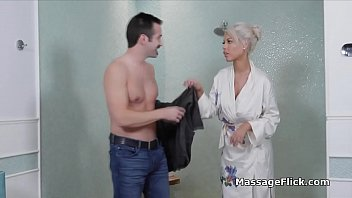Curvy MILF masseuse milks clients oiled cock