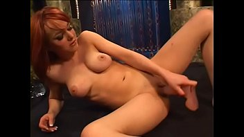 Redhaired cutie pie satisfies herself with huge dildo at the dancing floor of strip club