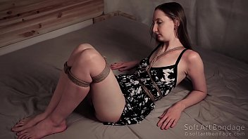 Hard tied seductive legs in short dress
