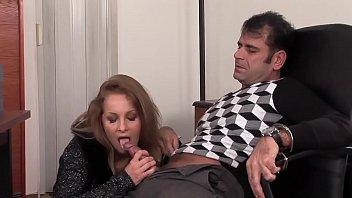 Blonde masturbates while jerking a prisoner with his feet
