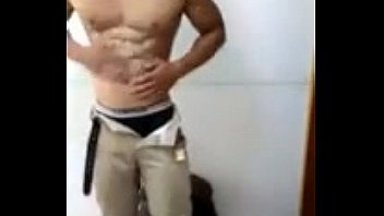Chinese guy oils and flexes his muscular body