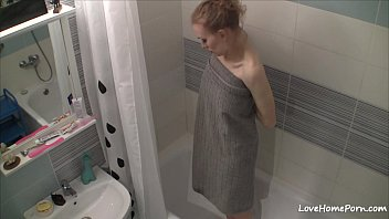 Curvy girl gets naked and takes a shower