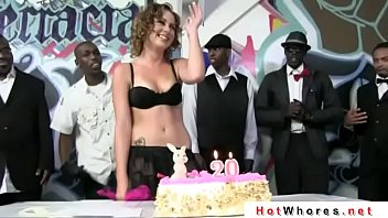 A crowd of men congratulated the whore on his 20th birthday