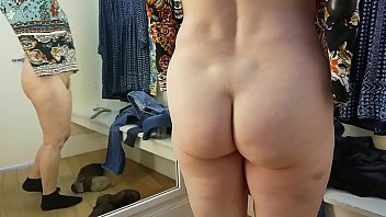 Sexy GILF goes commando store changing room