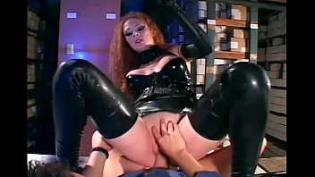 Nurse in latex - Sexy redhead getting fucked in shiny black latex