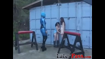 Latex Mistress Aradia restrains young dykes before toying