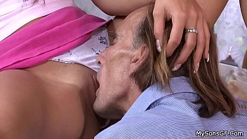 Pigtailed brunette spreads legs for oldman