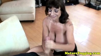 Busty granny giving tugjob