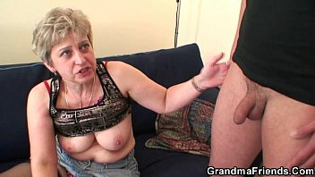 Nasty granny swallows two cocks at once