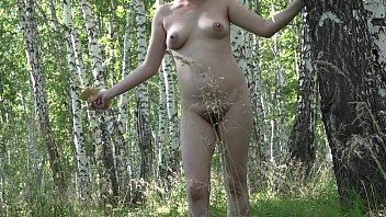 Unity with nature, a pregnant girl undresses in the forest, a public place outdoors.