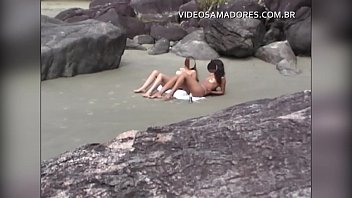 Voyeur tourist catches two girls doing topless on Brazilian beach