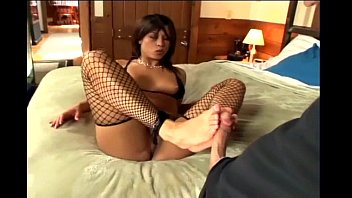 Black fetish stocking - Kinky footjob in ripped up black fishnet stockings