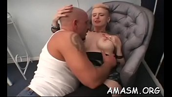 Exposed beauty facesitting man during female domination show