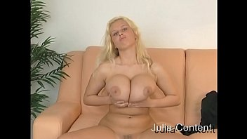 She is blond and has big breasts