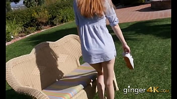 Redhead teases in the garden and shows wet white Tshirt