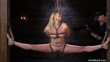 Slave in full split suspension on hogtie
