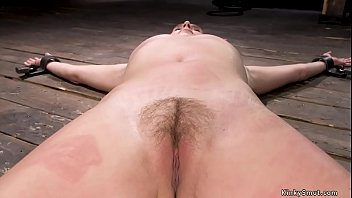 Hairy twat brunette slave is tormented