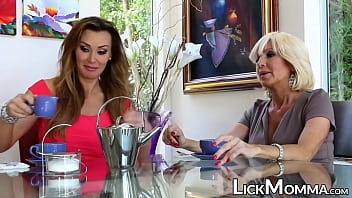 Naughty stepmom feasts on blond pussy and scissoring
