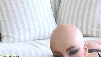 bald head luca bella in a hot latex corset