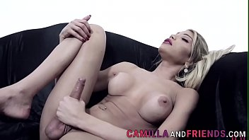 Busty transsexual blonde jerks her cock