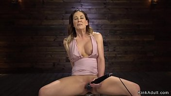 Shaved pussy Milf takes machine in bdsm image