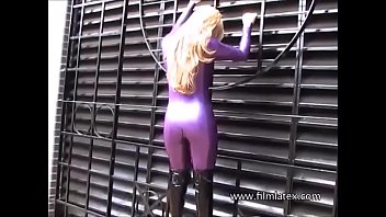 Kinky blonde Carlas outdoor latex fetish and rubber bodysuit on posing glamour softcore babe