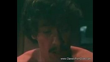 Hot Intruder is handcuffed and fucked by John Holmes