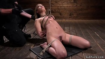 Blonde in ankle suspension tormented