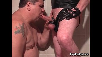 Gay guys giving blow jobs Older fat guy giving a hand and blow job in the bathroom