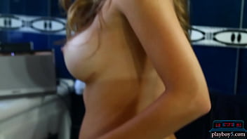 Big fake tits MILF model strips naked in her bathroom