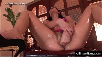 Oily bitch gets ass fucked with a mobile phone