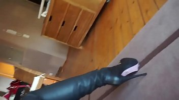 julie skyhigh fitting her leather catsuit & thigh high boots