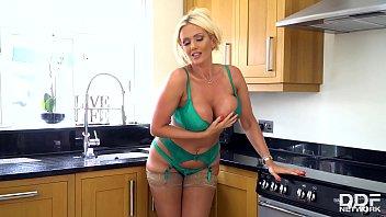 Busty blonde babe Lucy Zara oils her stunning body on the kitchen floor