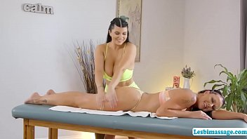 Busty brunette gives her sister in law a massage