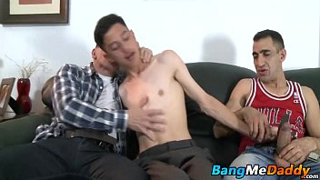 Two mature gay dudes drill one young twink in his juicy bum