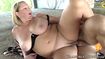 GILF cowgirl makes young construction worker cum