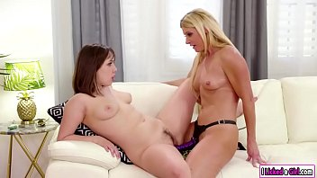 Milf shows stepdaughter how to use dildo