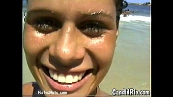 Candid teen girl showers Latina in bikini flashes tits at beach