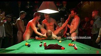 Hunk laying on table among gay cocks