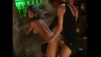Two superb girlfriends fuck each other with strapon and muscular guy