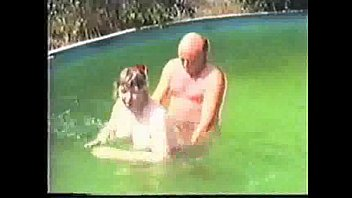 Older amateur couple in pool