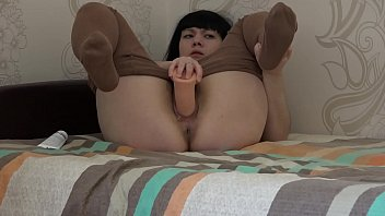 Brunette in vintage retro tights masturbates on the bed, big dildo fucks hairy pussy.